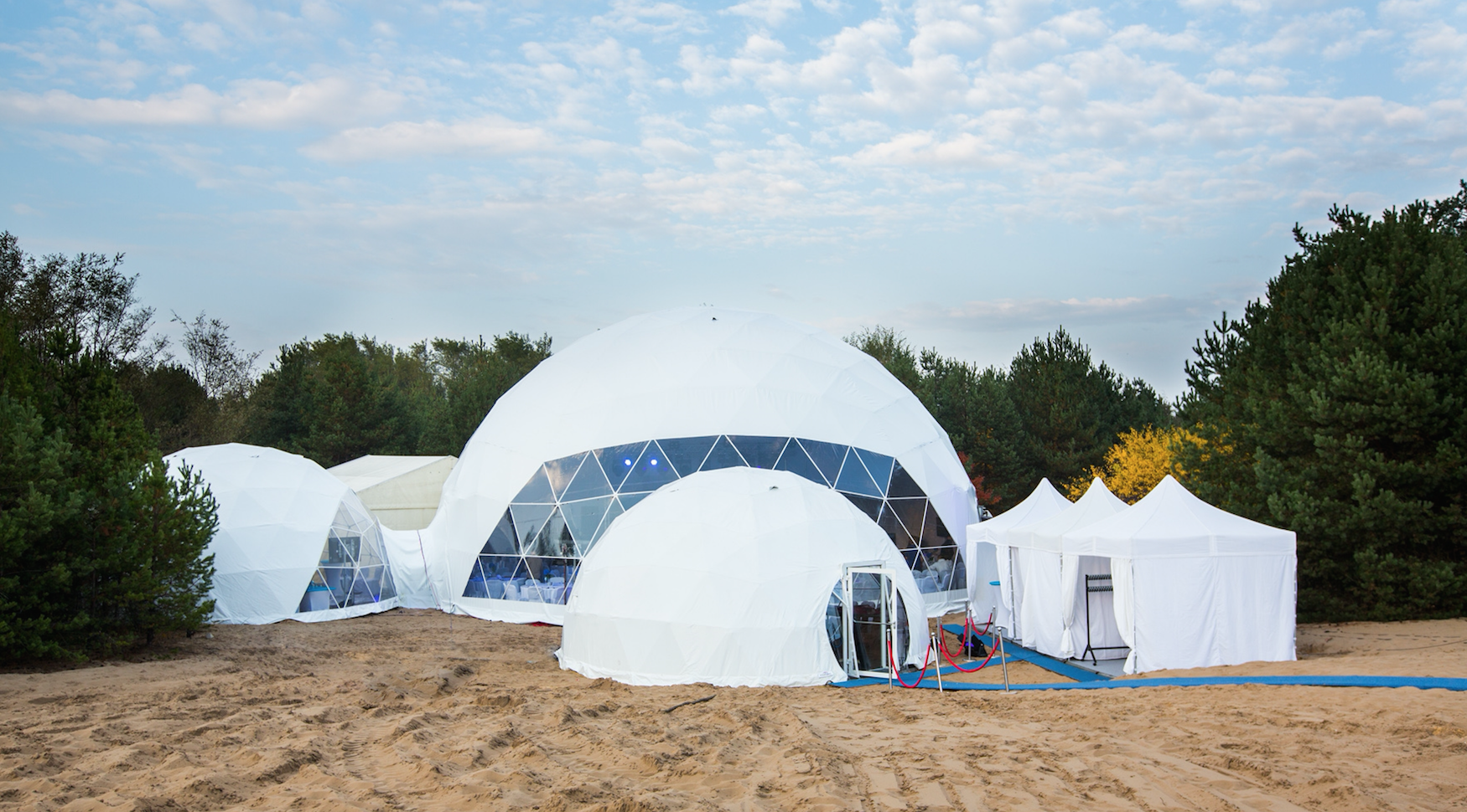 Geodesic dome tents on the desert by Polidomes