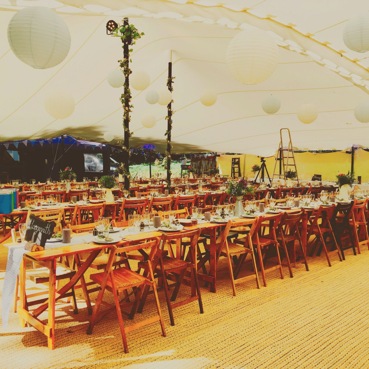 Our vintage chairs and solid wooden tables complement the decor of the tent nicely.
